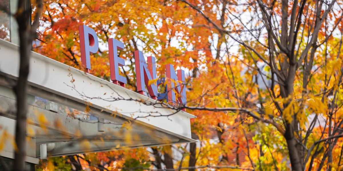 PENN sign on a building in fall